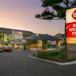 Best Western Plus Lincoln Sands Oceanfront Suites Sunset Exterior and Sign